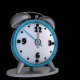 Alarm clock isolated on black background Royalty Free Stock Photos