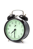 Alarm clock isolated over white Royalty Free Stock Photography