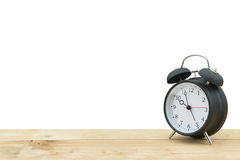 Alarm clock isolated with wooden floor Royalty Free Stock Photos