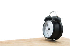Alarm clock isolated on wooden floor Stock Images