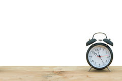 Alarm clock isolated on wooden floor Royalty Free Stock Photography