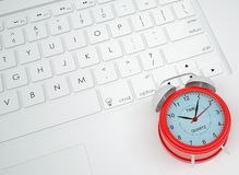 Alarm clock on the keyboard Stock Images