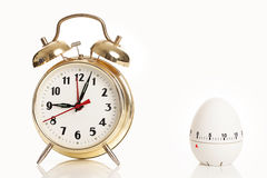 Alarm clock and kitchen timer Stock Photos