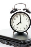 Alarm clock and laptop Royalty Free Stock Images