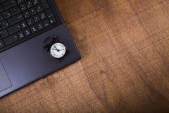 Alarm clock on laptop. Royalty Free Stock Image