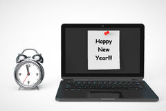 Alarm Clock with Laptop computer and Happy New Year sign Stock Photos