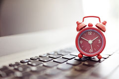 Alarm clock on laptop. Concept for business deadline, schedule and urgency royalty free stock photos