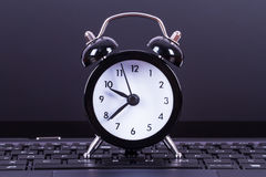 Alarm Clock on Laptop Stock Images