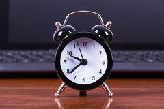 Alarm Clock and Laptop Stock Photography