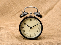 Alarm clock on linen Royalty Free Stock Images