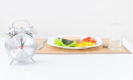 Alarm clock and lunch. Royalty Free Stock Photos