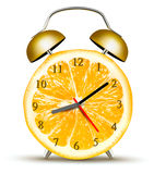 Alarm clock made of an orange. Stock Images
