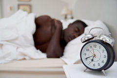Alarm clock man sleeping Stock Photo