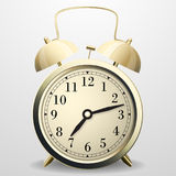 Alarm clock. Mechanical table clock with arrows, dial and metal bell percussion Royalty Free Stock Image