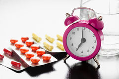 Alarm clock and medical pills Royalty Free Stock Images