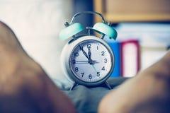 Alarm clock in the morning, legs stock photos