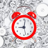 Alarm clock on metal cog gears background Royalty Free Stock Images