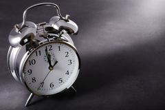 Alarm clock at midnight stock photo