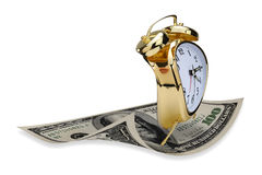 Alarm clock and money Stock Photos