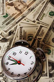 Alarm clock and money royalty free stock image