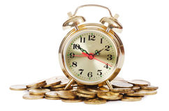 Alarm clock and money Royalty Free Stock Photos