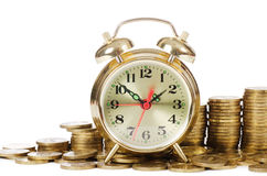 Alarm clock and money Royalty Free Stock Images