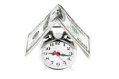 Alarm clock with money Stock Photo