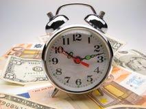 Alarm clock and money Stock Photos