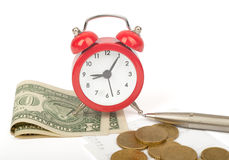 Alarm clock with money Royalty Free Stock Photography