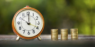 Alarm clock and money coins. Business success and time concept banner Royalty Free Stock Image
