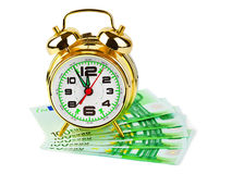 Alarm clock and money Stock Photo