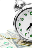 Alarm clock and money. On a white background. Royalty Free Stock Image