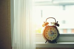 Alarm clock in the morning royalty free stock photo