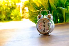 Alarm clock on wood table royalty free stock photos