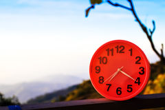 Alarm clock on natural landscape season park Stock Images