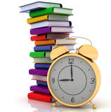 Alarm clock near stack of books Royalty Free Stock Photography