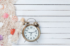 Alarm clock and net with shells and bottle Royalty Free Stock Image