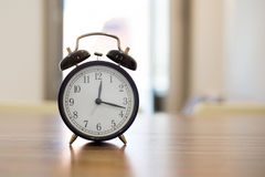 Alarm clock. On the nightstad Royalty Free Stock Photography
