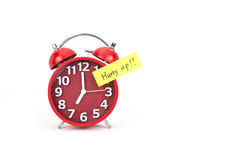 Alarm clock with a note Stock Images