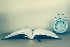 Alarm clock and notebook, diary for memo story Royalty Free Stock Photos