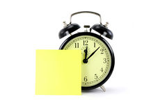 Alarm clock and notepaper. With white background Stock Images