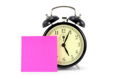 Alarm clock and notepaper, time to go home Royalty Free Stock Photo