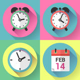Alarm clock, office clock and calendar with a date of Valentines Day. Royalty Free Stock Photos