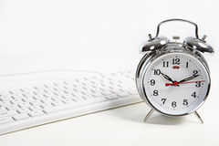 Alarm-clock in the office Royalty Free Stock Images