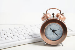 Alarm-clock in the office Stock Photos