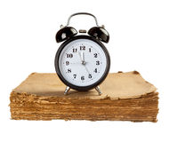 Alarm clock on old book Royalty Free Stock Image