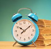 Alarm clock and old books Stock Photo