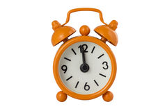 Alarm clock. Old Orange alarm clock, showing to midnight. Isolated on white Stock Image