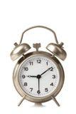Alarm clock. Old windup loud alarm clock  on white background Stock Photography
