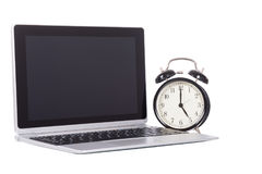 Alarm clock with open blank laptop computer Royalty Free Stock Image
